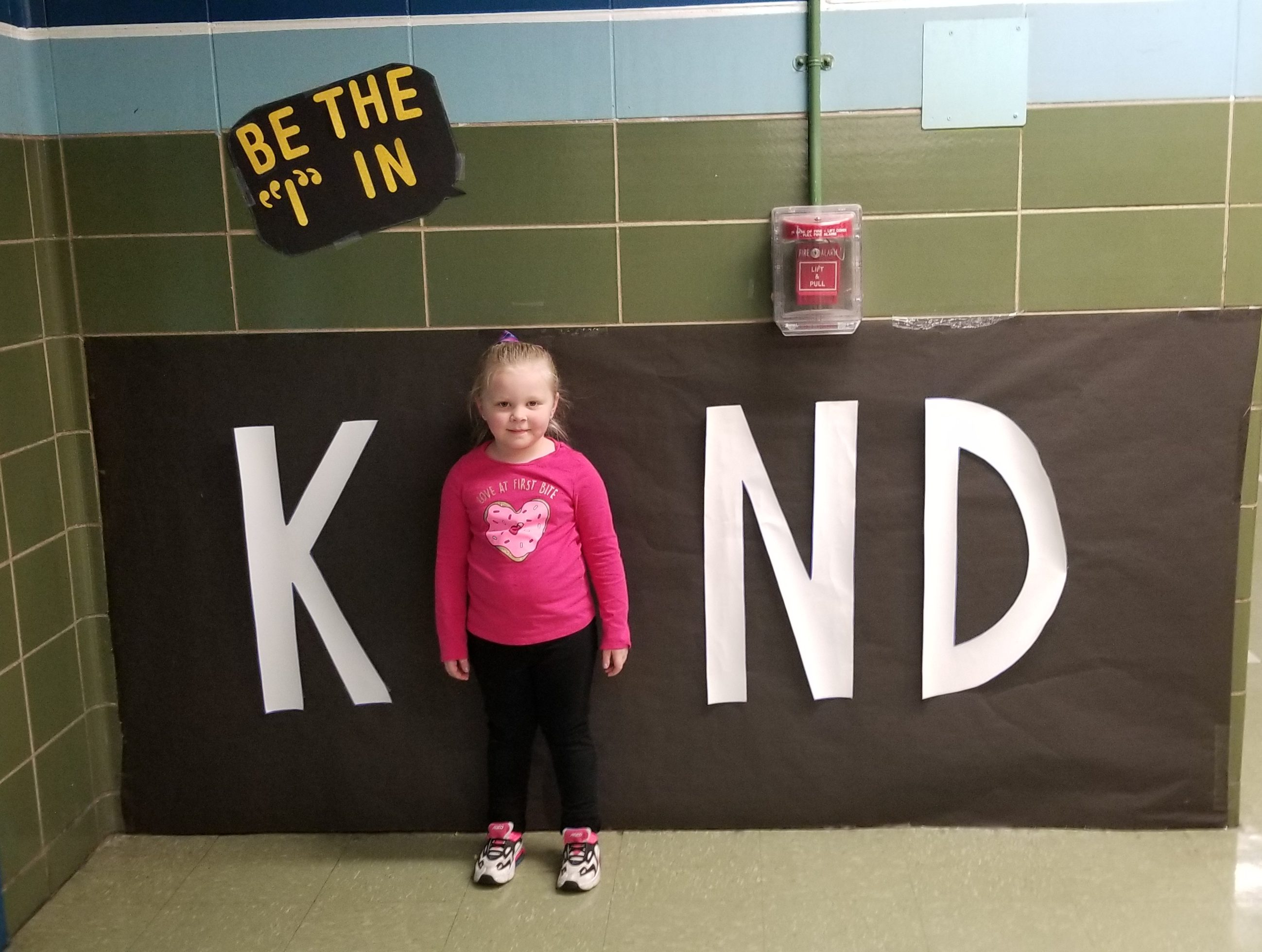 Student in a Kind sign